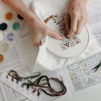 A close up of a person using an embroidery hoop at High Street Quilting