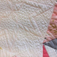A close up of free motion quilting