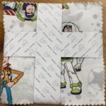 A picture of Toy Story charm pack by Camelot fabrics