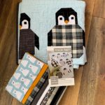 A picture of Penguin Party Quilt Kit by Elizabeth Hartman